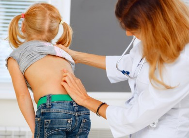 Child being checked for scoliosis.