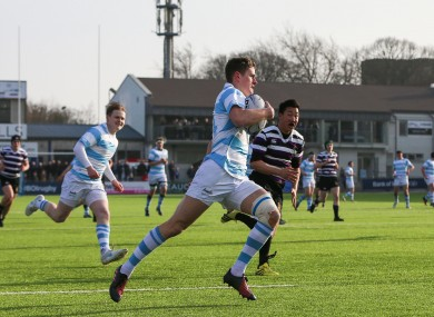 Tom Maher runs in his first try.