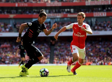 Roberto Firmino and Nacho Monreal when Liverpool and Arsenal met back in August.