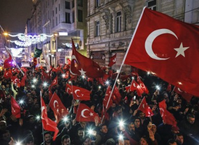 Protesters wave flags outside the Dutch consulate in Istanbul.