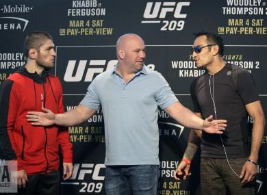UFC president Dana White stands between Tony Ferguson, right, and Khabib Nurmagomedov.