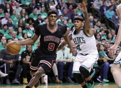 Chicago Bulls guard Rajon Rondo drives towards the basket past Isaiah Thomas of the Celtics.