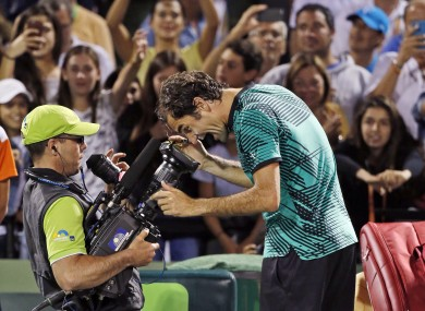 Roger Federer, of Switzerland, clowns for the camera after defeating Nick Kyrgios, of Australia, 7-6 (9) 6-7 (9) 7-6 (5) in a tennis match at the Miami Open.