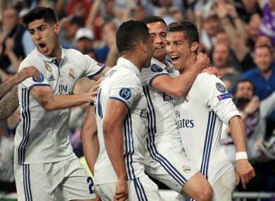 Real Madrid's Cristiano Ronaldo celebrates scoring his side's third goal of the game in extra time.