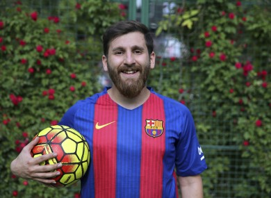 Reza Parastesh Iranian doppelganger or look-alike, of Argentinian superstar Lionel Messi, poses for a photo in an urban soccer field in Tehran.