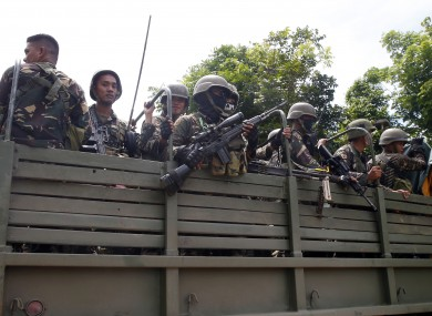 Philippine government troops are shipped in to fight the militants.