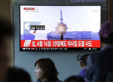 People watch a TV news program showing a file image of a missile launch conducted by North Korea, at the Seoul Railway Station in Seoul, South Korea.
