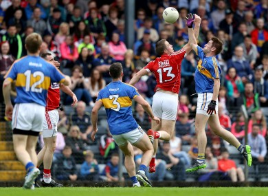 Colm O'Neill and Bill Maher battle for the ball.