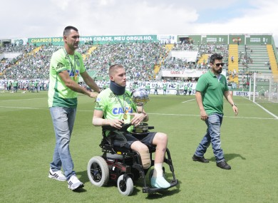 Chapecoenses goalkeeper Jackson Follmann holding the Copa Sudamericana before a friendly with Palmeiras.