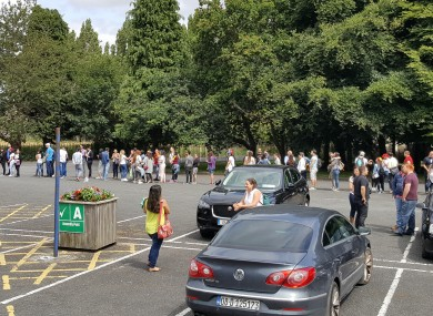 A view of the long queue of people waiting to vote in Tallaght this morning.