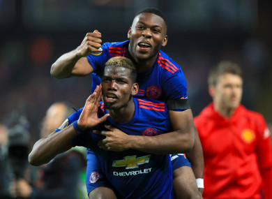 The defender celebrating United's Europa League win with Paul Pogba.