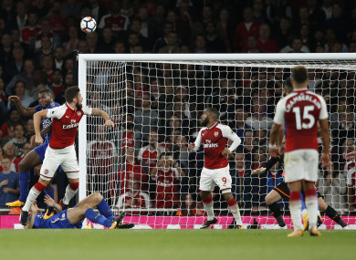Arsenal's Olivier Giroud, left heads the ball to score his sides 4th goal of the game.