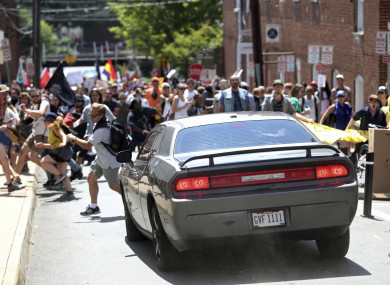 A vehicle plows into a group of protesters marching along 4th Street NE at the Downtown Mall in Charlottesville on the day of the Unite the Right rally.