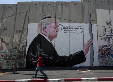 A mural resembling the work of elusive artist Banksy depicting President Donald Trump wearing a Jewish skullcap.