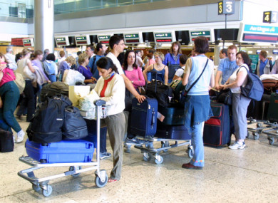File photo of passengers waiting to board planes at Dublin Airport.