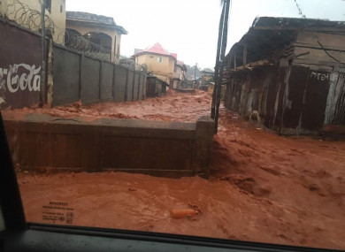 Mud and water burst through the streets of Freetown, Sierra Leone.