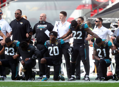 Jacksonville Jaguars players kneel in protest during the national anthem before the NFL International Series match at Wembley Stadium, London.