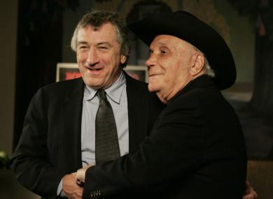 Robert DeNiro and boxer Jake LaMotta stand for photographers before watching a 25th anniversary screening of the movie Raging Bull in New York in 2005.