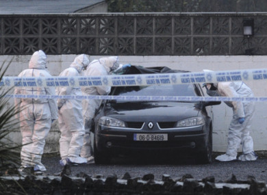 Gardai examine a car in the wake of the 2013 shooting at the Huntsman Inn.