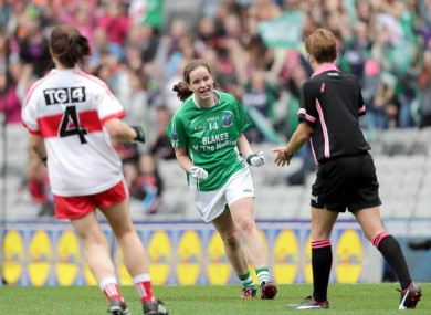 Sharon Murphy celebrates scoring her vital penalty.