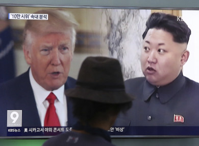 File photo of a man watches a TV screen showing a local news programme reporting about North Korea's missiles.