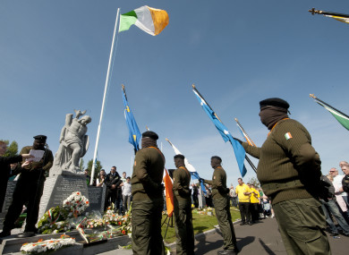 File: The 32 County Sovereignty Movement Easter Commemoration in 2011 sees a member of the Real IRA read a statement.