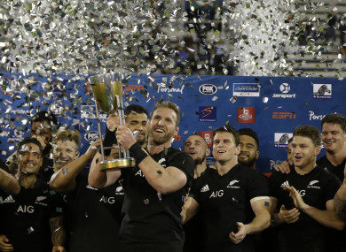 Kieran Read holds up the trophy.