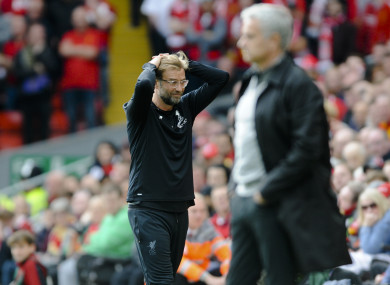 Klopp with Mourinho in the foreground.