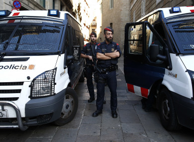 Catalan police officers stand guard next to the Palau Generalitat in Barcelona, Spain,
