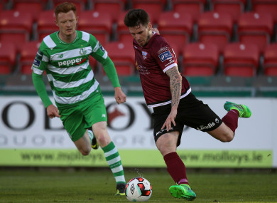 Folan in action alongside Gary Shaw of Shamrock Rovers.