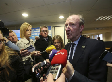Transport Minister Shane Ross speaks to reporters today.