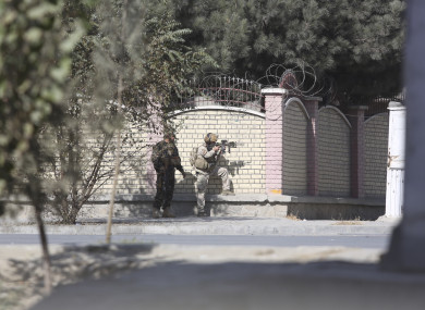 Afghan security personnel take a position near the Shamshad Television after an attack in Kabul.