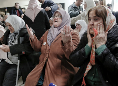 Bosnian women react to Ratko Mladic's sentence at the memorial center in Potocari, near Srebrenica, yesterday.