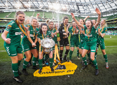 The Cork City players celebrate with the trophy.