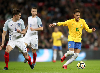 Neymar alongside John Stones at Wembley Stadium.