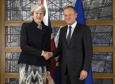 Donald Tusk and Theresa May shake hands on Monday of this week.