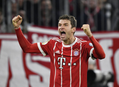 Thomas Müller celebrates scoring against Borussia Dortmund.