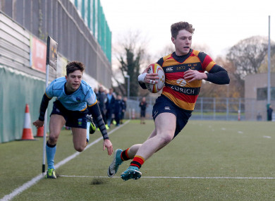 Lansdowne's Mark O'Keefe on his way to scoring a try.