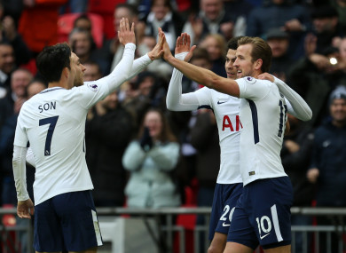 Tottenham Hotspur's Harry Kane (right) celebrates scoring his side's fifth goal of the game.