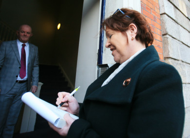 O'Sullivan signing a copy of the book
