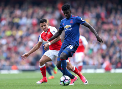 Tuanzebe alongside Man United's new signing Alexis Sanchez at the end of last season.