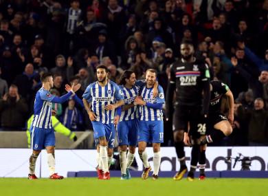 The Brighton players celebrate Murray's winner.