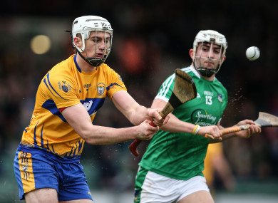 Clare's Conor Cleary and Limerick's Aaron Gillane in action.