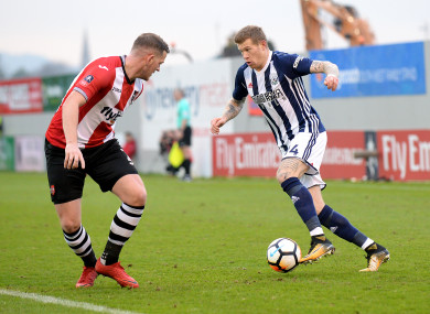 McClean (pictured here alongside Exeter City's Pierce Sweeney) has been with the Baggies since 2015.