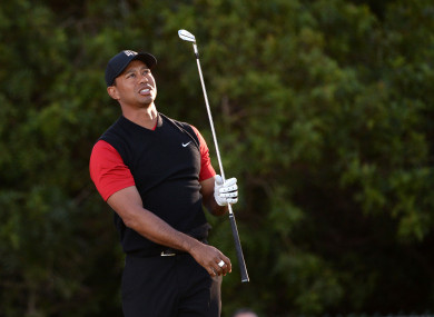Tiger Woods plays his shot from the 11th tee during the final round of the Farmers Insurance Open golf tournament at Torrey Pines Municipal Golf Course.