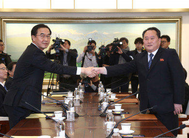 South Korean Unification Minister Cho Myoung-gyon, left, poses with head of North Korean delegation Ri Son Gwon.