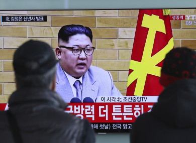South Koreans watch a TV news program showing North Korean leader Kim Jong Un's New Year's speech, in Seoul.