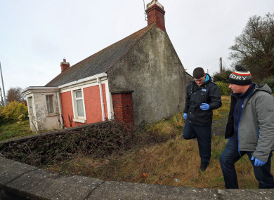 Garda searching a vacant property in Dundalk close to the scene of the murder of a Japanese man.