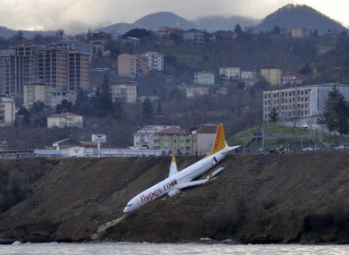 A Boeing 737-800 of Turkey's Pegasus Airlines after skidding off the runway downhill towards the sea at the airport in Trabzon.