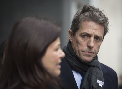 British actor Hugh Grant leaves the Rolls Building in London after settling his phone-hacking claims against Mirror Group Newspapers.